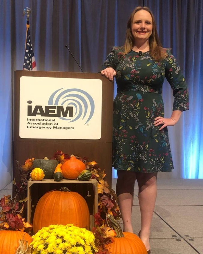 Photo of Jenny Novak on stage at IAEM
